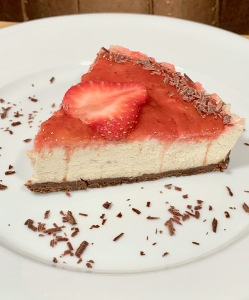 raw cheesecake with strawberries and chocolate crust