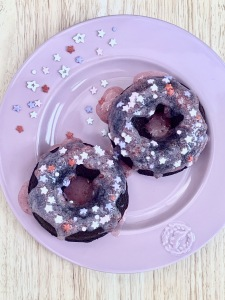 chocolate donuts with strawberry topping